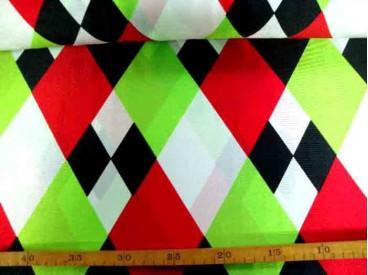 Een glanzende carnavals stof met gekleurde wiebertjes. 100% polyester  1.50 mtr. breed