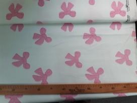 Lina Brown. Een offwhite katoen met grote roze strikjes. 100% katoen 1.45 mtr.br.