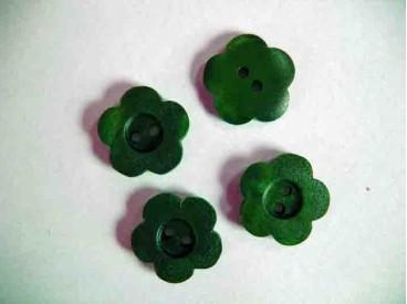 Groene kunststof knoop. 18 mm. doorsnee.