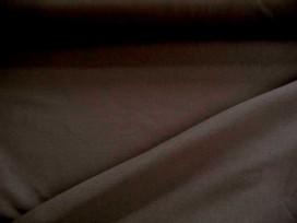 Iets dikkere kwaliteit donkerbruine tricot. Ook heel geschikt voor jurkjes en rokjes. 70%pe/27%visc./3%sp. 1.50 mtr.br.