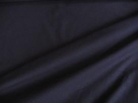 Iets dikkere kwaliteit donkerblauwe tricot. Ook heel geschikt voor jurkjes en rokjes. 70%pe/27%visc./3%sp. 1.50 mtr.br.