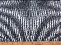 Een zwarte poplin katoen met witte mini driehoekjes en cirkels 100% katoen 1,40 mtr. breed