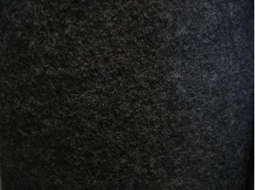 Wol bouclé. Zwarte voorgekookte boucle wolvilt. Zeer geschikt voor jasjes en mantels. 100% wol.  1.45 mtr.br. 410gr/m2