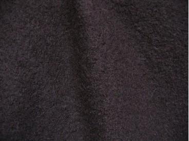 Mooie zware kwaliteit voorgekookte diep donkerbruine boucle wolvilt.  Zeer geschikt voor jasjes. Rafelt niet!  100% wol  1.45 mt