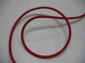 Koord elastiek rood. Ongeveer 3 mm dik.  Een rol van 50 meter en de prijs is per rol.
