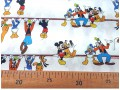Disney stof Met Micky Mouse and friends  100% Gekaard poplin katoen (100% American Carded Cotton Poplin)  150 cm breed.  120 gr/