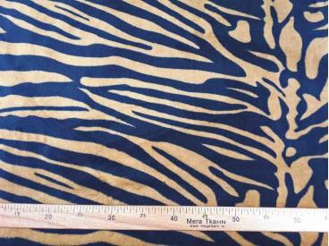 Een superzachte coral  fleece met een bruine tijgerprint  100% polyester  1,50 meter breed  240 gram p/m²