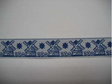 Wit sierband met blauwe molens. 23 mm. br. Past heel mooi bij de boerenbont serie.
