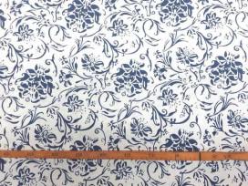 Een witte canvas met delftsblauw bedrukte bloem, die iets wat stug aanvoelt. 100% katoen 1.50 mtr. br.