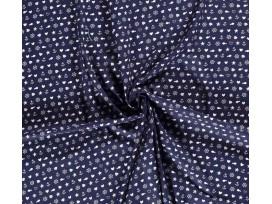 Een donkerblauwe poplin/katoen met een witte zeevaart print. 100% katoen 1.45 mtr.br. 110 gram p/m2