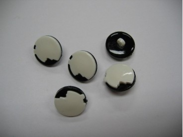 Zwart/witte kunststof knoop. 18 mm. doorsnee