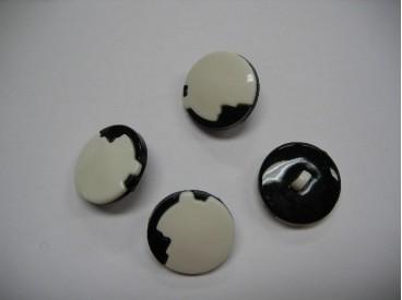 Zwart/witte kunststof knoop. 20 mm. doorsnee.