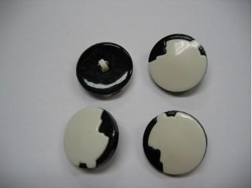 Zwart/witte kunststof knoop. 25 mm. doorsnee