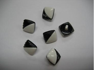 Zwart/witte kunstof knoop. 15. mm. doorsnee