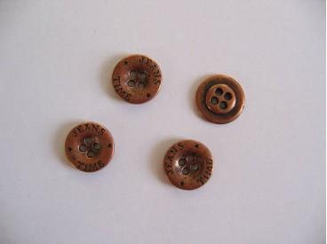 Koperkleurige metalen jeansknoop. 15 mm. doorsnee.