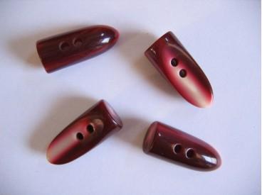 Glanzende bordeaux kleurige kunststof knebelknoop. 35 x 15 mm.