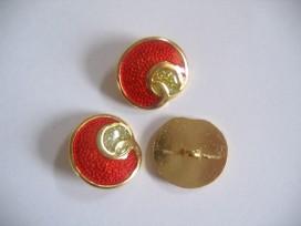 Goudkleurige metalen damesknoop, rode knoop met zilveren glitter. Doorsnee 22 mm.