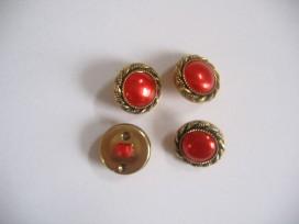 Goudkleurige kunststof rode damesknoop. Doorsnee 15 mm.