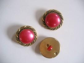Goudkleurige kunststof pinkkleurige damesknoop. Doorsnee 28 mm.