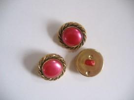 Goudkleurige kunststof pinkkleurige damesknoop.Doorsnee 20 mm.