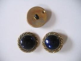 Goudkleurige kunststof donkerblauwe damesknoop. Doorsnee 28 mm.