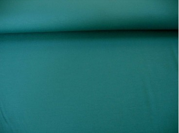 Petrolkleurige viscose tricot.  92%visc./8%el.  1.60 mtr.br.  225 gr/m²
