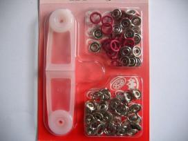 Babydrukkers. Rode inslag baby drukknopen met werktuig. Een open rondje. Doorsnee 9.7 mm. 15 stuks per pakje