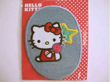 5f Hello Kitty ovaal jeans Zittend met lolly kitty105