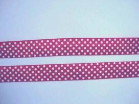 Fuchia kleurig elastisch biaisband met witte stip. 2 cm. breed