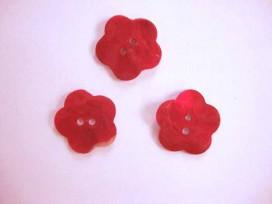 Een rode bloemknoop van parelmoer met een doorsnee van 20 mm.