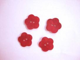 Een rode bloemknoop van parelmoer met een doorsnee van 18 mm.