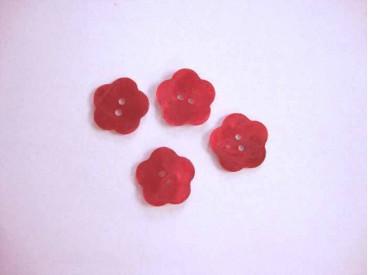 Een rode bloemknoop van parelmoer met een doorsnee van 15 mm.