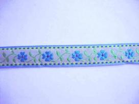 Lichtzand kleurig sierband met een aqua bloem en een lichtblauw randje.  20 mm. breed