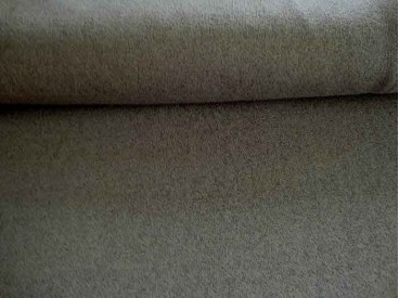 Een soepelvallende gebreide donkergrijze tricot.  Voelt aan als katoen.  100% polyester  1.45 mtr. br.