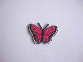 Een opstrijkbare vlinder applicatie van 3 x 2.5 cm. Pink