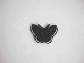 Een opstrijkbare vlinder applicatie van 3 x 2.5 cm. Zwart
