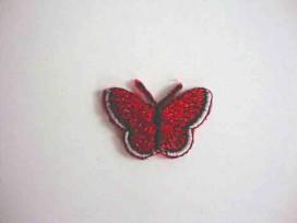 Een opstrijkbare vlinder applicatie van 3 x 2.5 cm. Rood glitter