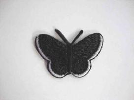 Een opstrijkbare vlinder applicatie van 5 x 3.5 cm. Zwart