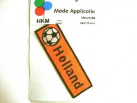 Een opstrijkbare applicatie van 10 x 3 cm.  Holland