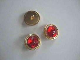 Een ronde rood/gouden diamantknoop met een doorsnee van 22mm.