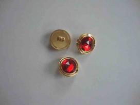 Een ronde rood/gouden diamantknoop met een doorsnee van 18mm.