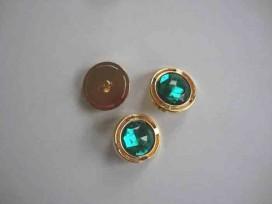 Een ronde groen/gouden diamant knoop met een doorsnee van 22mm.