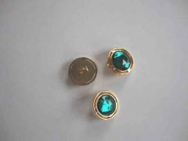 Een ronde groen/gouden diamantknoop met een doorsnee van 18mm.