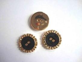 Een zwart/gouden kunststof knoop met een gouden golfrandje en een doorsnee van 30 mm,
