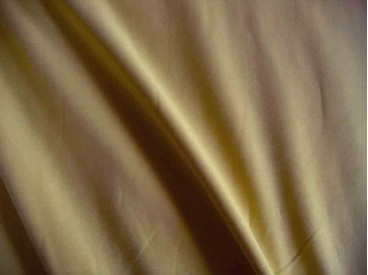 Donker zandkleurige viscose tricot.  92%visc./8%el.  1.60 mtr.br  225 gr/m²