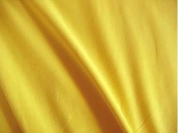 Mosterd kleurige viscose tricot.  92%visc./8%el.  1.60 mtr.br  225 gr/m²