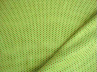 Limekleurige tricot met mini pinkkleurige stippen. Rekt zowel in de breedte als in de lengte. 95%co/5%el. 1,50 mtr. br. 200gr/m2