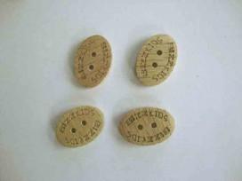 Een houten knoop van 25x15 mm.  Van 0,65 voor 0,30 euro