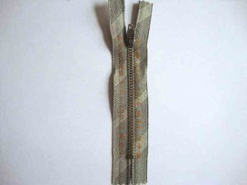 Broekrits metaal div. fijn 10 cm. met oranje tekst