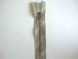 Broekrits metaal div. fijn 10 cm. met zandkleurige tekst